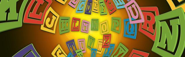Wörter wirken, das zeigt das Alphabet des Denkens - bunte Buchstaben im Raum kreisend angeordnet